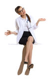 Carefree Female Doctor Sitting Royalty Free Stock Images