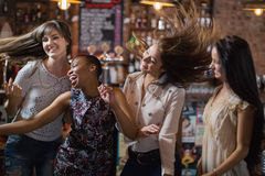 Carefree female friends dancing Stock Photos