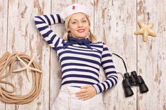Carefree female sailor lying on a deck Royalty Free Stock Photography
