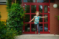 The carefree first grader rejoices to the beginning of summer vacation. Royalty Free Stock Photos