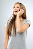 carefree flickamobiltelefon arkivfoton