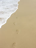 Carefree footprints. On the beach Stock Image