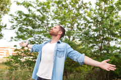 Carefree and free man raising his arms Royalty Free Stock Photos
