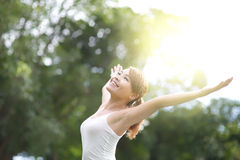 Carefree and free woman. Carefree and free cheering woman in the park. girl raising her arms up smiling happy. asian beauty stock images