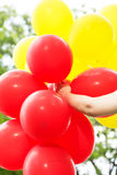 Carefree , Freedom Woman with Red and Yellow Balloons Royalty Free Stock Images