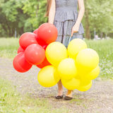 Carefree , Freedom Woman with Red and Yellow Balloons Royalty Free Stock Photography