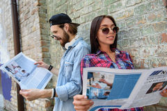 Carefree friends are interested in news royalty free stock photography