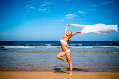 Carefree girl on the beach Royalty Free Stock Images