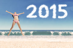 Carefree girl at beach with numbers 2015 Royalty Free Stock Photos