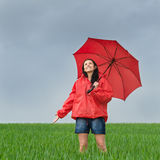 Carefree girl enjoying rain shower outdoors. Looking up royalty free stock images