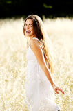 Carefree girl in field Royalty Free Stock Photo