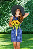 Carefree girl is happy in field with flowers Royalty Free Stock Photography
