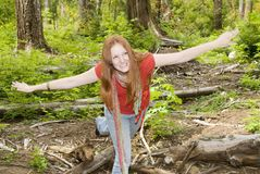 Carefree girl having fun in forest Stock Photography