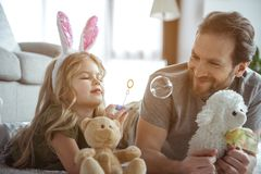 Carefree girl having fun with her daddy at home royalty free stock photos