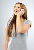 Carefree girl with mobile phone Stock Photos