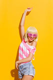 Carefree girl in pink glasses Royalty Free Stock Image
