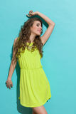 Carefree girl posing in lime green dress Stock Image