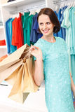 Carefree girl shopping in store Royalty Free Stock Photos