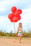 Carefree girl in summer Stock Images