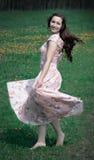 Carefree Girl Twirling Around Stock Image