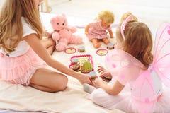 Carefree girls enjoying bun-fight at home royalty free stock photo