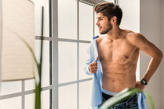 Carefree guy preparing for work at home Royalty Free Stock Images