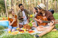 Carefree guys and girls resting in nature Royalty Free Stock Photography