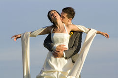 Carefree happy bride and groom Royalty Free Stock Photography