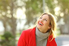 Carefree happy girl laughing looking above outdoors Royalty Free Stock Photos