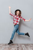 Carefree happy girl in plaid shirt celebrating success Royalty Free Stock Photos