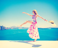 Carefree happy woman enjoying life in summer. Vintage, retro style filter royalty free stock images