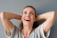 Carefree happy woman laughing with hands in hair Royalty Free Stock Photography