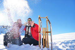 Carefree happy young couple having fun together in snow. Stock Photography