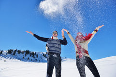 Carefree happy young couple having fun together in snow. Stock Images