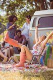 Carefree hipster having fun on campsite Royalty Free Stock Image