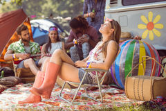 Carefree hipster having fun on campsite Royalty Free Stock Images