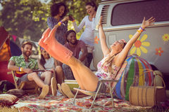 Carefree hipster having fun on campsite Stock Image