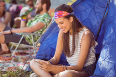 Carefree hipster sending text message Royalty Free Stock Images