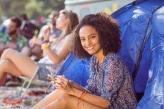 Carefree hipster sending text message Stock Photos