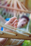 A carefree holiday. Man has a rest in a hammock and yawns Stock Image