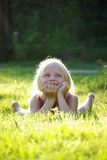 Carefree joyful little girl on gras royalty free stock photography