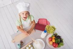 Carefree kid baking healthy food Royalty Free Stock Photos