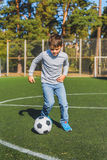 Carefree kid entertaining with ball Stock Photography