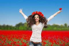 Carefree laughing brunette woman with open arms jumping up over Royalty Free Stock Photo