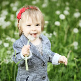 Carefree little girl laughing outdoors - fun! Stock Images