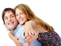 Carefree lyckliga par i studio royaltyfri fotografi