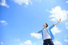 Carefree man feel happy. Carefree and free man raised hands and looking to a sky, asian Royalty Free Stock Image