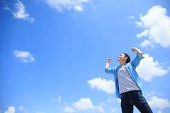 Carefree man feel happy. Carefree and free man raised hands and looking to a sky, asian Royalty Free Stock Photo