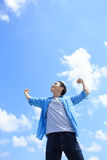 Carefree man feel happy. Carefree and free man raised hands and looking to a sky, asian Royalty Free Stock Photos