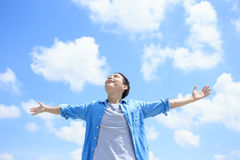 Carefree man feel happy. Carefree and free man raised hands and looking to a sky, asian Stock Photos